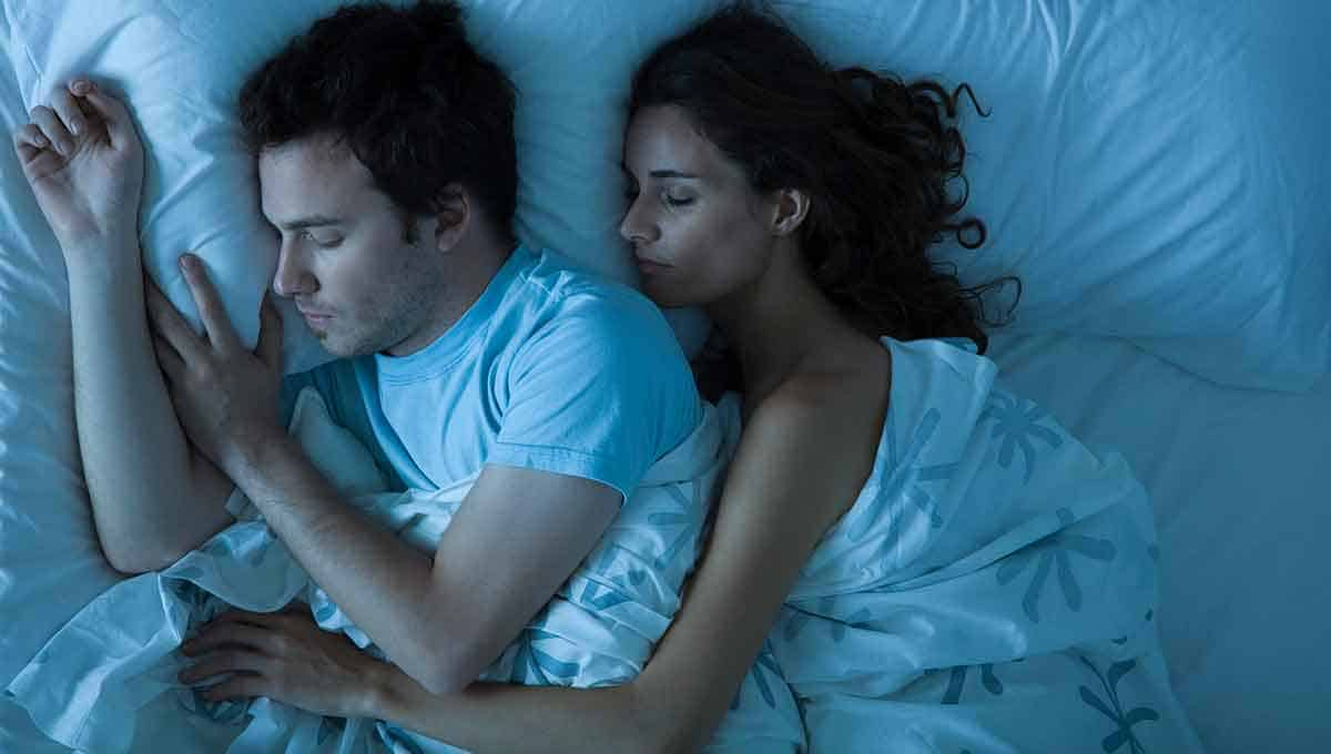 Couple hugging having good night's sleep