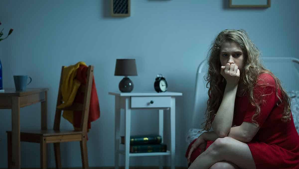 Woman sitting suffering from anxiety disorder