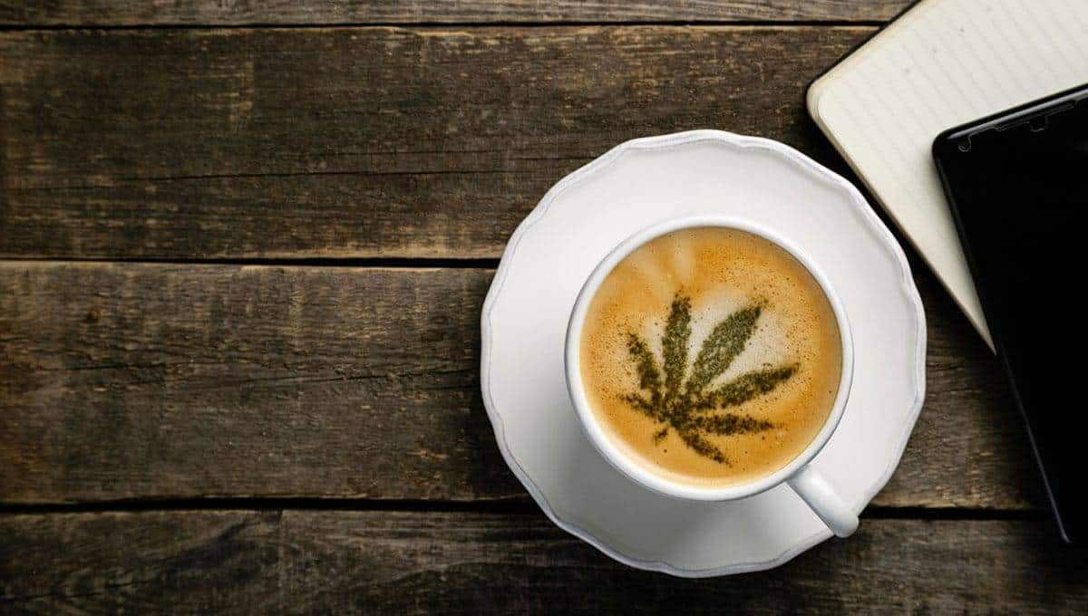 cbd coffee on the wooden table with book and phone