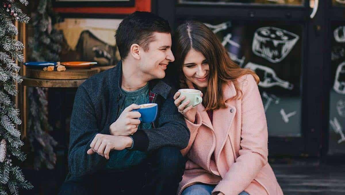 happy couple drinking cbd coffee
