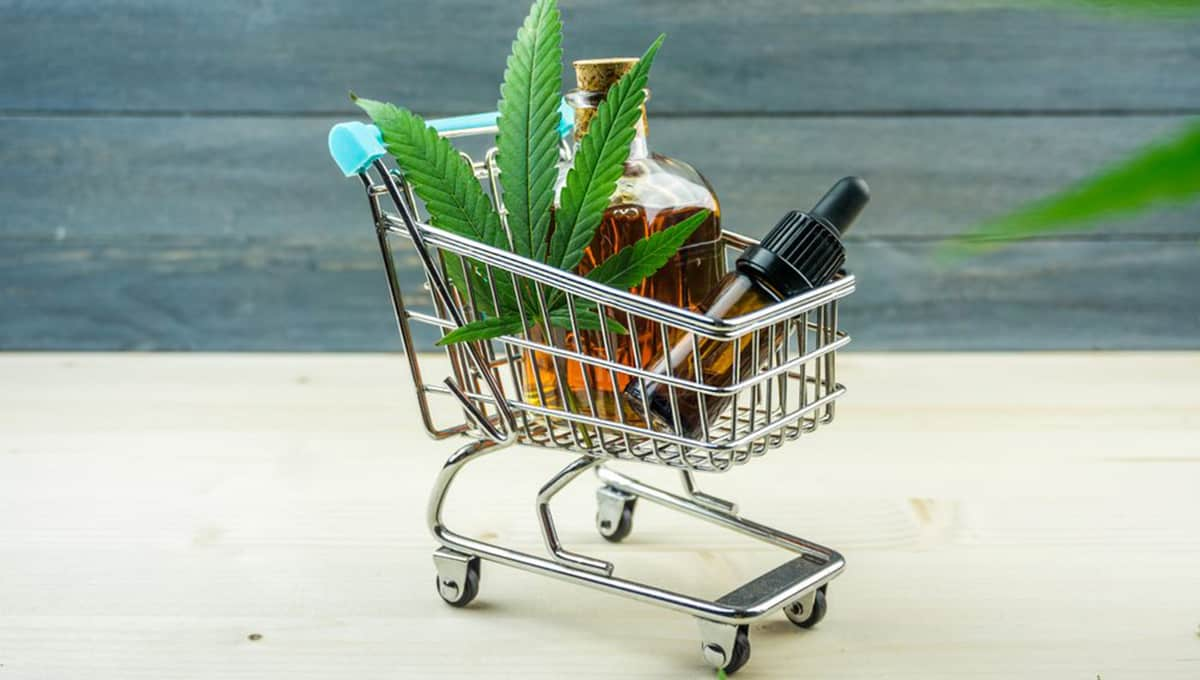 Pure CBD oil inside container placed inside mini cart